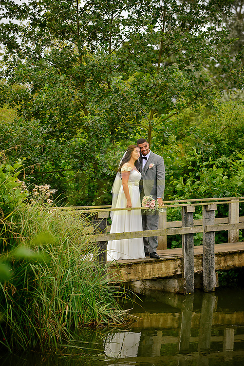 Bride and Groom on rustic bridge at The Three Lakes, Westmill Farm, Hertfordshire