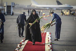 TEHRAN, Oct. 3, 2015 (Xinhua) -- An Iranian woman arranges flowers before a ceremony to pay tribute to 104 Iranian pilgrims killed in the latest Hajj stampede and transferred to Mehrabad airport in Tehran, capital of Iran, on Oct. 3, 2015. Rouhani on Saturday urged for an investigation into the latest Hajj stampede in Saudi Arabia which left 465 Iranian pilgrims dead. (Xinhua/Ahmad Halabisaz) (Credit Image: © Ahmad Halabisaz/Xinhua via ZUMA Wire)