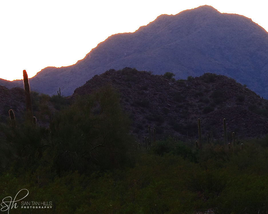 Quiet sunset over San Tan Regional Park, casts a shade of purple on the hills - Queen Creek, AZ