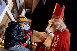 01.12.2016, Riedlhof, Lienz, AUT, Osttiroler Krampustage im Bild ein Mann als Heiliger Nikolaus verkleidet beim traditionellen Osttiroler Tischziachn // Members of the Krampusgroup NIKRAMO during the traditional Osttiroler table drawing. Krampus a mythical creature that, according to legend, accompanies Saint Nicholas during the festive season. Instead of giving gifts to good children, he punishes the bad ones, Lienz, Austria on 2016/12/01. EXPA Pictures © 2016, PhotoCredit: EXPA/ JFK