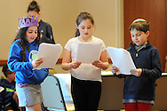 "From left, Samantha Kravitz, Averi O'Brian and Benjamin Pearlberg perform ""Let My People Go"" as they participate in Passover Palozza in preparation for the holiday Sunday April 17, 2016 at Congregation Beth El in Lower Makefield, Pennsylvania. (Photo by William Thomas Cain)"