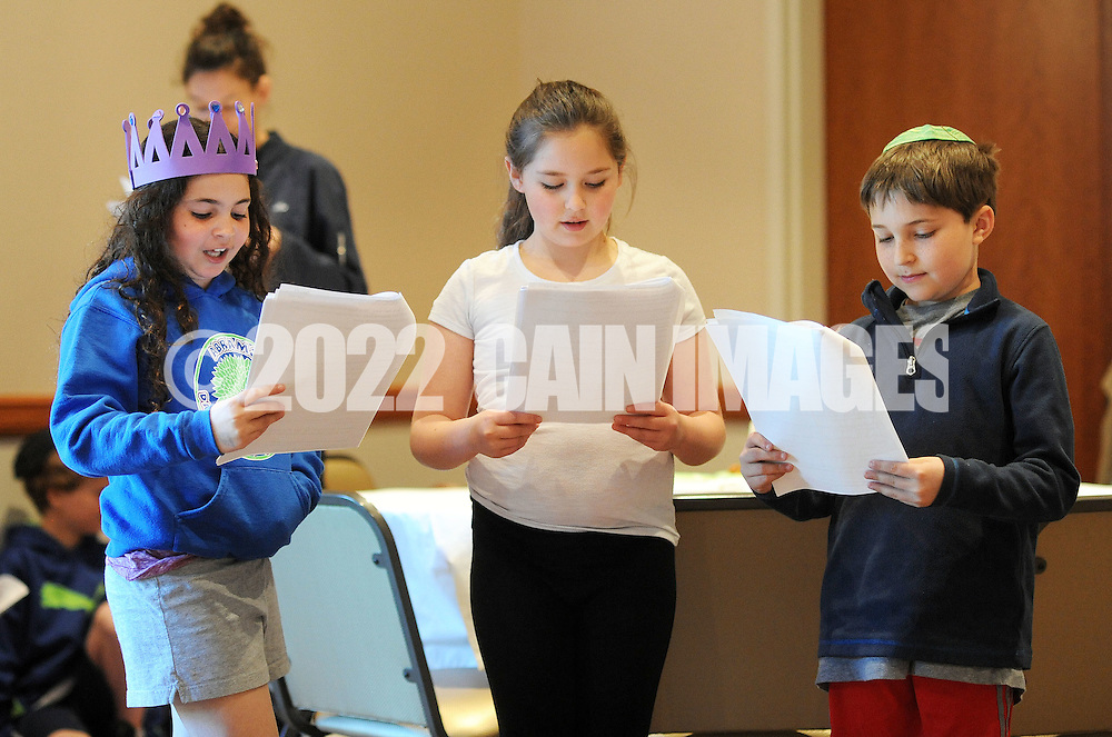 """From left, Samantha Kravitz, Averi O'Brian and Benjamin Pearlberg perform """"Let My People Go"""" as they participate in Passover Palozza in preparation for the holiday Sunday April 17, 2016 at Congregation Beth El in Lower Makefield, Pennsylvania. (Photo by William Thomas Cain)"""