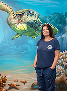 Artist Anat Ronen with the murals she created in the Sensory Room at ABS West, May 19, 2020.