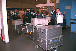 LIVERPOOL, ENGLAND - Monday, September 11, 1995: Liverpool's assistant manager Doug Livermore and Ronnie Moran load the skips at Liverpool Airport before travelling to Russia ahead of the UEFA Cup 1st Round 1st Leg match against FC Alania Spartak Vladikavkaz. (Photo by David Rawcliffe/Propaganda)