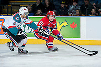 KELOWNA, CANADA - MARCH 5: Madison Bowey #4 of the Kelowna Rockets checks Mike Aviani #16 of the Spokane Chiefs on March 5, 2014 at Prospera Place in Kelowna, British Columbia, Canada.   (Photo by Marissa Baecker/Getty Images)  *** Local Caption *** Madison Bowey; Mike Aviani;