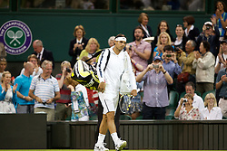 LONDON, ENGLAND - Thursday, June 28, 2012: Rafael Nadal (ESP) arrives back on court after the match was interrupted because of bad light and the roof closed during the Gentlemen's Singles 2nd Round  match on day four of the Wimbledon Lawn Tennis Championships at the All England Lawn Tennis and Croquet Club. (Pic by David Rawcliffe/Propaganda)