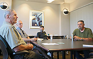 Roger Wiest (from left), of Cedar Rapids, Richard Hrvol, of Cedar Rapids, Jay Kaiser, of Cedar Rapids, and Doug Adamson, of Center Point, talk about the proposed veterans center at Wells Fargo Bank in Cedar Rapids on Tuesday, July 16, 2013.