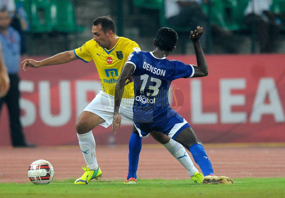 Michael Chopra of Kerala Blasters FC and Denson Devadas of Chennaiyin FC fight for the ball during match 9 of the Hero Indian Super League between Chennaiyin FC and Kerala Blasters FC held at the Jawaharlal Nehru Stadium, Chennai, India on the 21st October 2014.<br /> <br /> Photo by:  Pal Pillai/ ISL/ SPORTZPICS