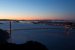 """Golden Gate Bridge Sunrise 5"" - Photograph of San Francisco's famous Golden Gate Bridge at sunrise. San Francisco can be seen in the distance."