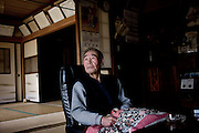 """Miyakoji, April 26 2011 - In the gost town of Miyakoji, a 21km from the nuclear power plant. The vlllage residents were not asked to evacuate but have to stay indoors. Almost everybody left though..Tokuzo Endo, 82, stays. His son and his daughter in law come everyday to bring him and cook some food. Tatsuo Endo  fought during WW2.""""I would like to go out, walk a bit, but I can't. Radioactivity is dangerous and we can't see it. It's so frightening. When they built the power plant in the 70ies, I was scared. I knew it could be as dangerous as the atomic bomb, 20km from my house. At that time, resident of the village were glad to find another way to earn money, as rice growing was declining. The March 11 accident opened their eyes on the dangerousness of the nuclear. We have to get rid of it. """""""