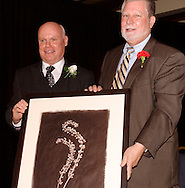 Michael Lippert (left) accepts the award for Arts Education  from Ohio Senate President Tom Niehaus during the Governor's Awards for the Arts in Ohio & Arts Day Luncheon at the Athenaeum in downtown Columbus, Ohio, Wednesday, May 11, 2011. The award is a photo by Dayton artist Francis Schanberger called Curl from his 'Forces of Nature' collection.