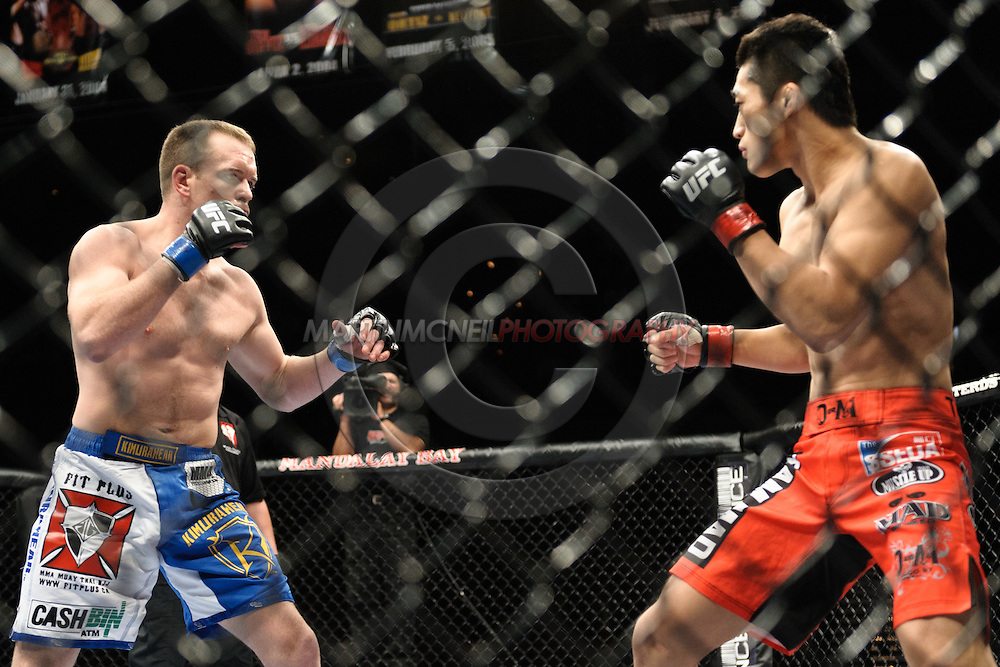 """LAS VEGAS, NEVADA. JULY 11, 2009: Dong Hyun Kim and TJ Grant during """"UFC 100: Making History"""" inside the Mandalay Bay Events Center in Las Vegas, Nevada."""