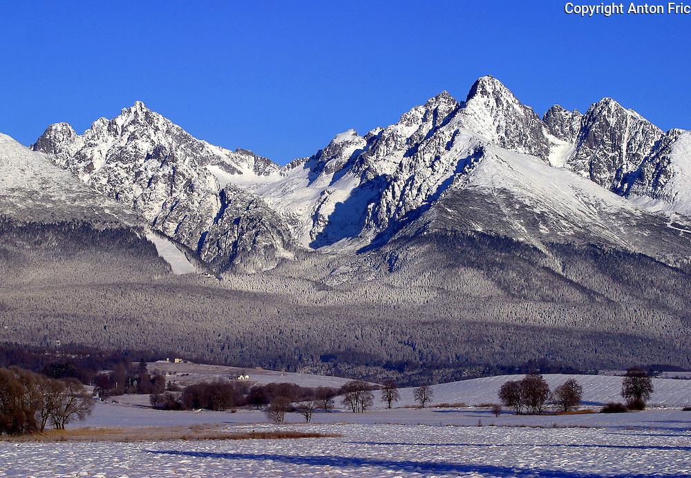 Winter view of High Tatras mountains from the road between Velky Slavkov and Nova Lesna. Pohlad na Vysoke Tatry z cesty medzi obcami Velky Slavkov a Nova Lesna.