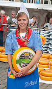 Pretty smiling girl in traditional Dutch costume, Gouda cheese market, South Holland, Netherlands, Europe
