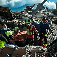 The August 24, 2016 an earthquake with normal kinematics of Mw 6.0 has hit central Italy, causing nearly 300 deaths and very serious damage to many historic towns.<br /> Since the beginning of the sequence, the National Seismic Network (INGV) has located more than 5000 events.<br /> The Civil Protection, volunteers, speleologists and Carabinieri retrieve a dead body from the rubble.