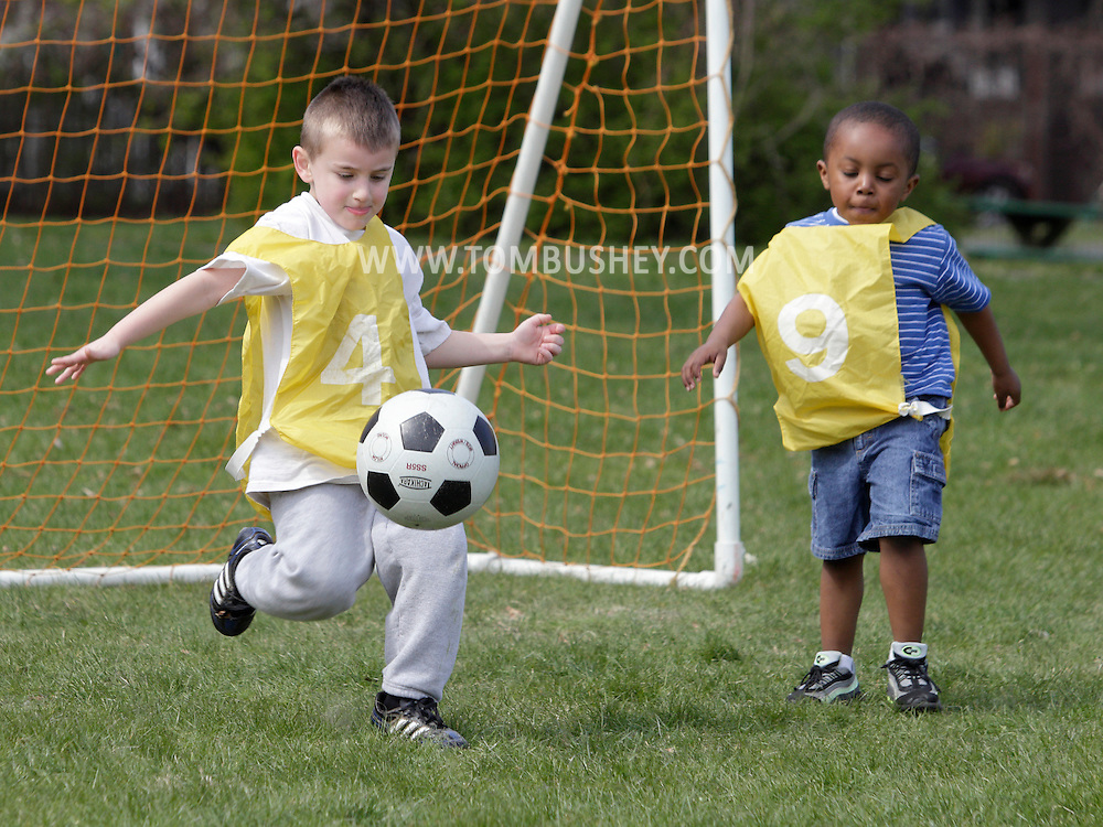 Middletown, New York - Children play soccer during a program at the Middletown YMCA on April 14, 2012.