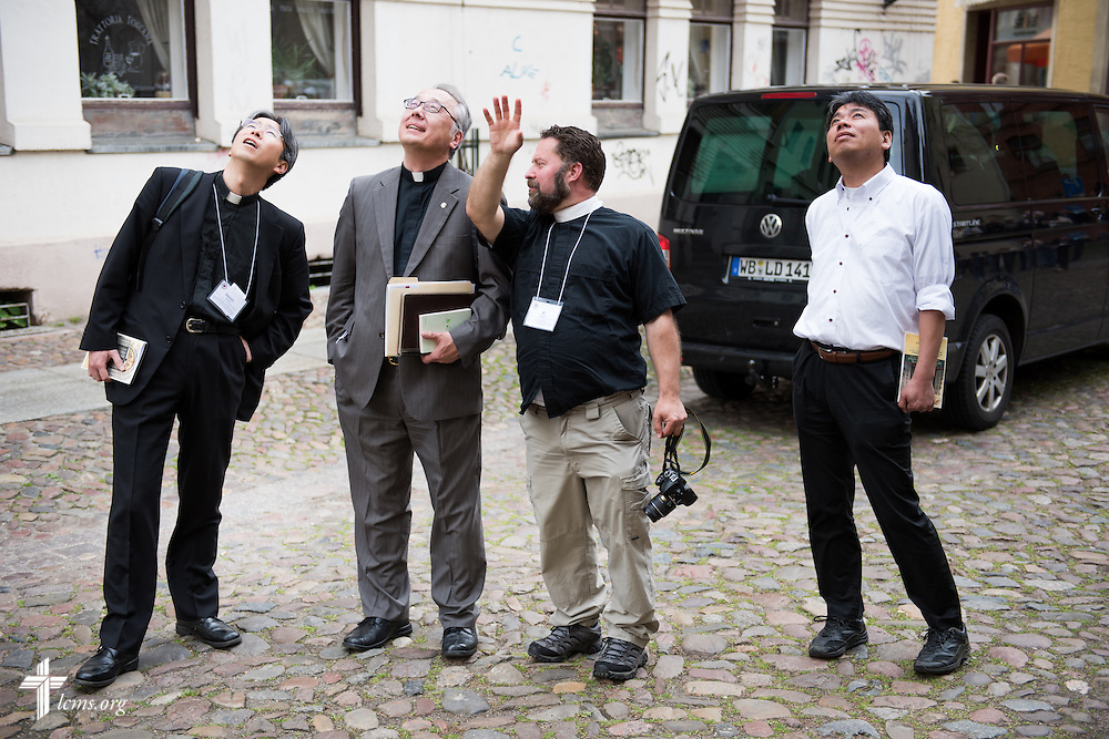 Rev. Dr. Albert C. Collver, director of Church Relations and Regional Operations for the LCMS, discusses architecture with fellow church leaders on Tuesday, May 5, 2015, during the International Conference on Confessional Leadership in the 21st Century in Wittenberg, Germany. LCMS Communications/Erik M. Lunsford