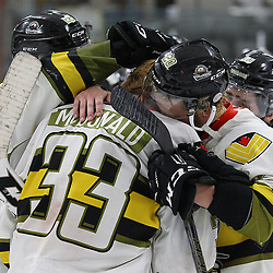 TRENTON, ON  - MAY 5,  2017: Canadian Junior Hockey League, Central Canadian Jr. &quot;A&quot; Championship. The Dudley Hewitt Cup Game 7 between Georgetown Raiders and the Powassan Voodoos.    Dayton Murray #20 hugs  Nate McDonald #33 of the Powassan Voodoos post game.<br /> (Photo by Alex D'Addese / OJHL Images)