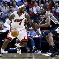 17 January 2012: Miami Heat small forward LeBron James (6) drives past San Antonio Spurs small forward Kawhi Leonard (2) during the Miami Heat 120-98 victory over the San Antonio Spurs at the AmericanAirlines Arena, Miami, Florida, USA.