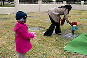 Tammy Simpson and her daughter Ryan place flowers on the grave site of her son, Troy E. Causey, Jr. who was killed on March 24, 2014 in Dallas, Texas on November 14, 2014.