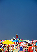 A lifeguard on a stand overlooking crowds at the beach. Cape Cod National Sea Shore, Massachusetts..
