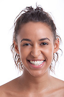 Portrait of young Mixed Race woman smiling against white background