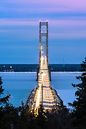 Looking straight on through the Mackinac Bridge at dusk.