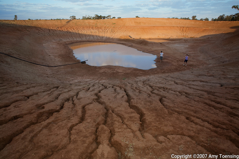 BARELLAN, NSW, AUSTRALIA - OCTOBER 22: The Kenny family's farm dam almost empty October 22, 2008 in Barellan, New South Wales, Australia. As dry-land farmers, the Kenny family depends completely on the water from rainfall for their the survival of their sheep stock and wheat farm. The Kenny family has worked this land for over a100 years (3 generations) and this is the first year they will have to sell off their entire stock due to lack of water from the drought. The Murray-Darling Basin in southeast Australia has been plagued with severe drought since the late 1990's and many growers and policy makers are being forced to work on implementing more efficient irrigation systems. (Photo by Amy Toensing / Reportage by Getty Images). _________________________________<br /> <br /> For stock or print inquires, please email us at studio@moyer-toensing.com.