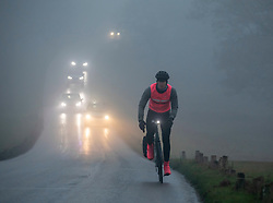 © Licensed to London News Pictures. 22/01/2020. London, UK. Cyclists head through the fog on Richmond Park … Another foggy start for commuters this morning in Richmond as forecasters predict lingering fog and milder weather for the week ahead. Photo credit: Alex Lentati/LNP