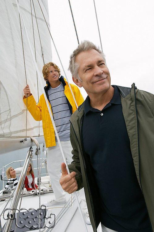 Father and adult son on yacht