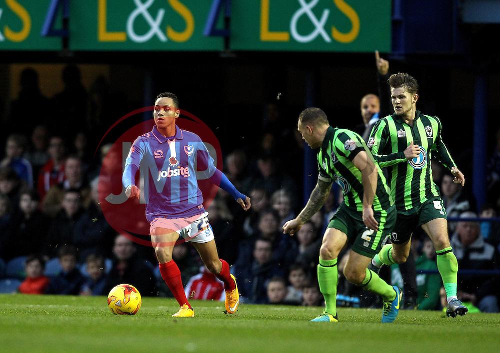 Kyle Bennett of Portsmouth takes on Barry Fuller of AFC Wimbledon - Mandatory byline: Robbie Stephenson/JMP - 07966 386802 - 15/11/2015 - Rugby - Fratton Park - Portsmouth, England - Portsmouth v AFC Wimbledon - Sky Bet League Two