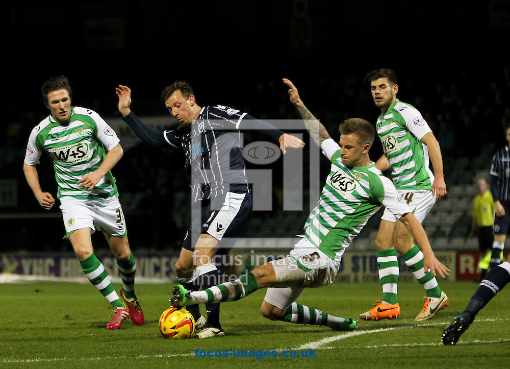 Byron Webster (centre right) of Yeovil Town slides in on Martyn Woolford (centre left) of Millwall during the Sky Bet Championship match at Huish Park, Yeovil<br /> Picture by Tom Smith/Focus Images Ltd 07545141164<br /> 11/02/2014