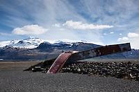 Part of old bridge over Skeiðarársandur. Hvannadalshnúkur in background.