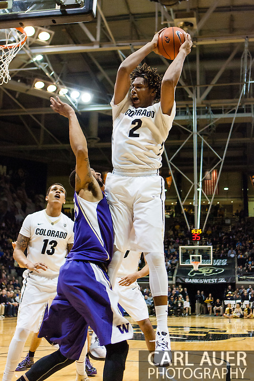 February 9th, 2014:  Colorado Buffaloes sophomore forward Xavier Johnson (2) grabs a offensive rebound the first half of action in the NCAA Basketball game between the Washington Huskies and the University of Colorado Buffaloes at the Coors Events Center in Boulder, Colorado