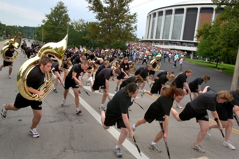 "The Ohio University Marching 110 Band greet the members of the 2006 freshman class outside the Convocation Center. ..OPENING SCHOOL IN STYLE -- Members of the 2006 freshman class at Ohio University will get their college careers off on the right foot, both literally and figuratively, with the traditional march through the College Gate at approximately 3:15 p.m. Monday, Sept. 4. Following the President's Convocation at 2:30 p.m. in the Convocation Center, the new Bobcats will follow ""The Most Exciting Band in the Land,"" the Marching 110, from the Convo for the trek up Richland Avenue toward the College Green as they officially begin their college careers..Once on the College Green, representatives of more than 200 student organizations across campus will have displays set up to introduce the newest Ohio University students to the many ways to become actively involved in campus life..It is a colorful tradition that captures the spirit of college life. It also makes for tremendous photo and video opportunities for a unique twist on the conventional moving-in activities as the academic years of schools, colleges and universities across the state hit full stride over Labor Day Weekend."