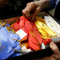 Thomas Wells | BUY at PHOTOS.DJOURNAL.COM<br /> Ribbons are stacked up ready to placed on the winning roses at Thursday's annual Rose Show held at Renasant Bank.