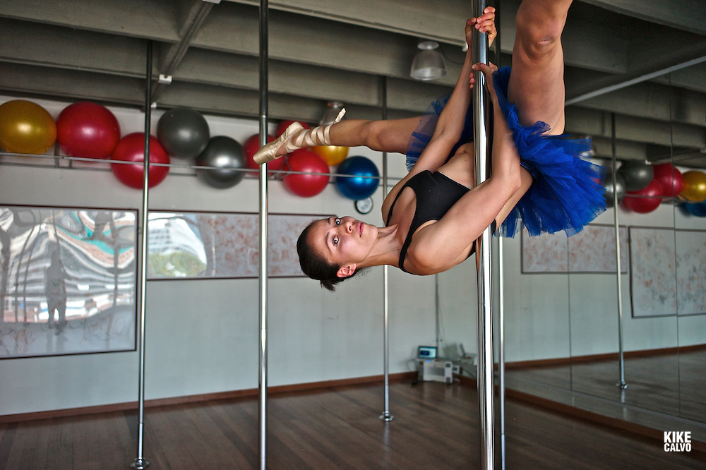Pole dancing, a form of performing art, combining dance and gymnastics its gaining many enthusiasts in gyms or dedicated dance studios in Latin America.   Location: Pole Dance Studio Bogota.