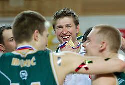 Vladimer Boisa  of Union Olimpija celebrates with a medal  after winning the basketball match between KK Helios Domzale and KK Union Olimpija in Final of Spar Slovenian Cup, on February 13, 2011 in Sportna dvorana Poden, Skofja Loka, Slovenia. Union Olimpija defeated Helios 92-55 and become Slovenian Cup Champion. (Photo By Vid Ponikvar / Sportida.com)