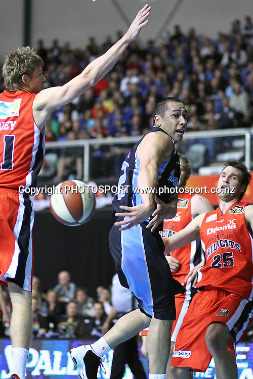 Breakers' Paul Henare with a behind-the-back pass. iinet ANBL, New Zealand Breakers vs Perth Wildcats, North Shore Events Centre, Auckland, New Zealand. Wednesday 20th October 2010. Photo: Anthony Au-Yeung / photosport.co.nz