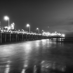 Santa Monica California Pier at night in black and white. Photo Copyright ⓒ 2017 Paul Velgos with All Rights Reserved.