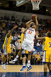 Virginia guard Monica Wright (22) shoots past UCSB forward/center Kat Suderman (10).  The #4 seed/#24 ranked Virginia Cavaliers defeated the #13 seed Santa Barbara Gauchos 86-52 in the first round of the 2008 NCAA Division 1 Women's Basketball Championship at the Ted Constant Convocation Center in Norfolk, VA on March 23, 2008