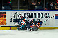 KELOWNA, CANADA - FEBRUARY 23:  Liam Kindree #26 of the Kelowna Rockets gets tangled up with Quinn Schmiemann #25 of the Kamloops Blazers on February 23, 2019 at Prospera Place in Kelowna, British Columbia, Canada.  (Photo by Marissa Baecker/Shoot the Breeze)