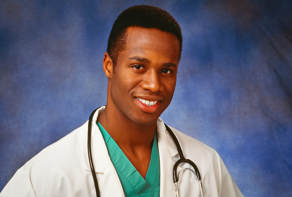 Studio portrait of young black doctor.