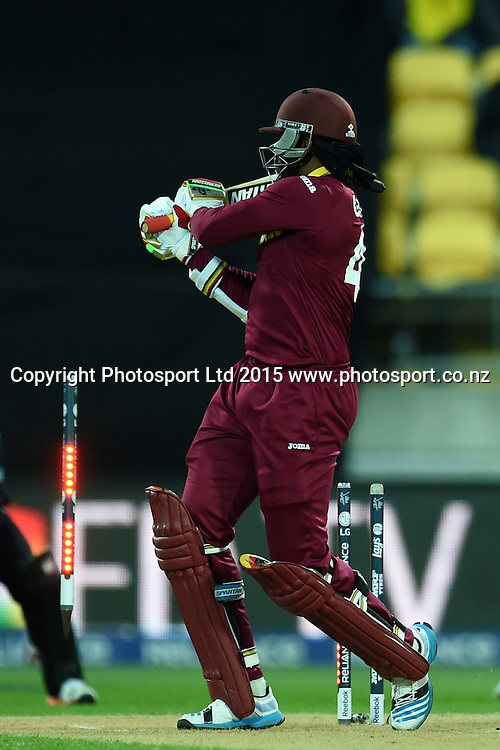 West Indies batsman Chris Gayle bowled off the bowling of Adam Milne during the ICC Cricket World Cup Quaterfinal match between New Zealand and West Indies at Westpac Stadium in Wellington, New Zealand. Saturday 21  March 2015. Copyright Photo: Raghavan Venugopal / www.photosport.co.nz