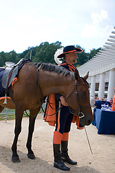 "CavMan and his horse Sabre posed for fans' photographs.  The Virginia Cavaliers football team held their annual ""Meet the Team"" event at Scott Stadium in Charlottesville, VA on August 12, 2007.  The event was open to the public and gave fans the opportunity to meet the players on the team and get their autographs."