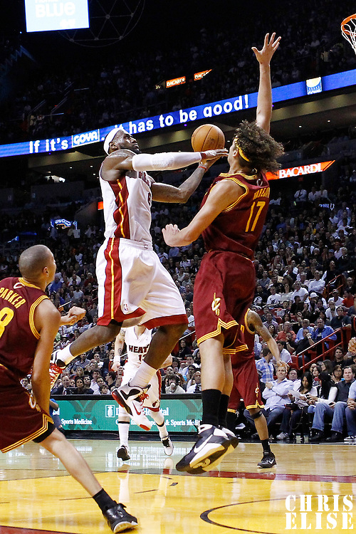 24 January 2012: Miami Heat small forward LeBron James (6) goes for the lay up against Cleveland Cavaliers power forward Anderson Varejao (17) during the Miami Heat 92-85 victory over the Cleveland Cavaliers at the AmericanAirlines Arena, Miami, Florida, USA.