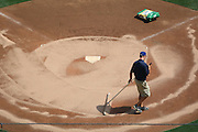 LOS ANGELES - MAY 03:  A groundskeeper works the infield dirt prior to the Los Angeles Dodgers game against the San Diego Padres at Dodger Stadium on Sunday, May 3, 2009 in Los Angeles, California.  The Dodgers won their 10th straight home game while defeating the Padres 7-3.  (Photo by Paul Spinelli/MLB Photos)