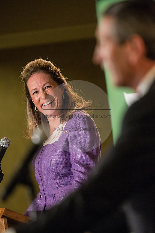Elizabeth Colbert Busch the democratic candidate for the open Congressional seat listens to her opponent republican Gov. Mark Sanford during their debate at the Citadel on April 29, 2013 in Charleston, South Carolina.
