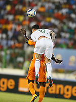 Carl Medjani  of Algeria in anaerial tackled against Ivory Coast during their AFCON 2015 Quarter Finals Match on February 1 2015 at Estadio de Malabo Equatorial Guinea. Photo/Mohammed Amin/www.pic-centre.com (Equatorial Guinea)