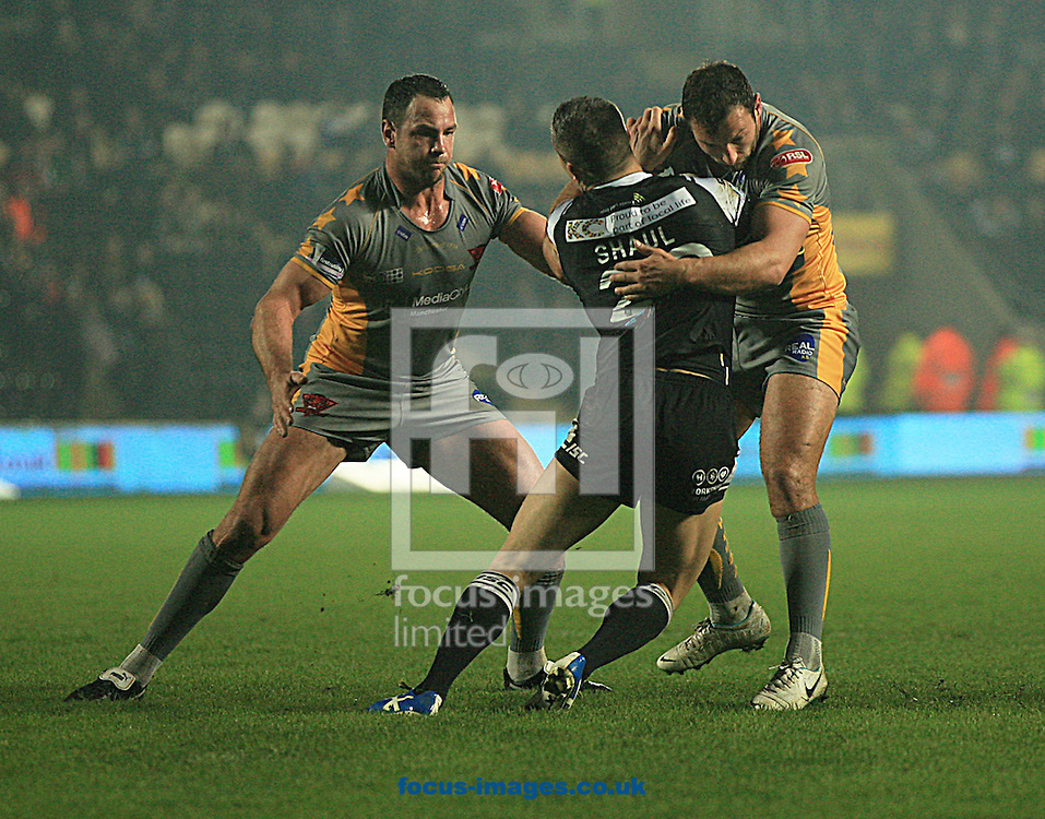 Jamie Shaul (centre) of Hull Football Club is stopped by Adrian Morley (left) &amp; Tommy Lee of Salford Red Devils during the First Utility Super League match at the KC Stadium, Kingston upon Hull<br /> Picture by Richard Gould/Focus Images Ltd +44 7855 403186<br /> 28/03/2014